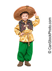 Smiling boy posing in a mushroom costume