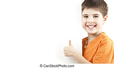 Smiling boy showing thumb