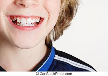 smiling boy -  Close up of a teenaged boy smiling