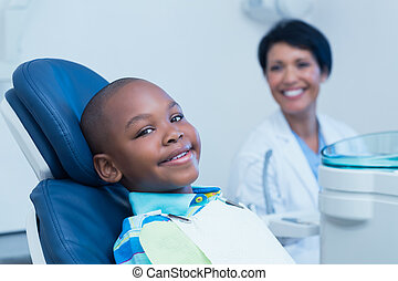 Smiling boy waiting for a dental exam - Portrait of smiling ...