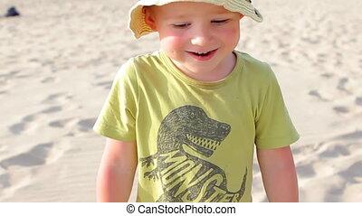 Smiling Boy Walking on the Beach