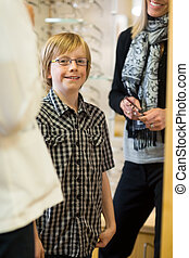 Smiling Boy Wearing Glasses In Store