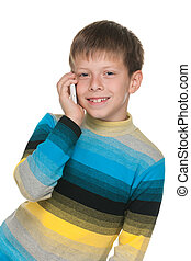 Smiling boy with a cell phone