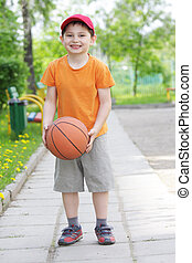 Smiling boy with basketball