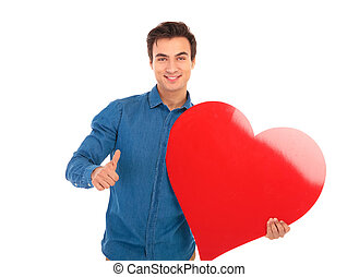 smiling boy with big red heart showing the ok sign