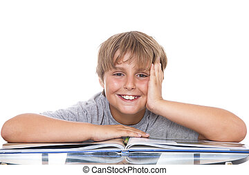 Smiling boy with  book on the table