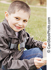 Smiling boy with book
