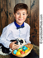 smiling boy with bunny