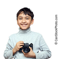 smiling boy with camera