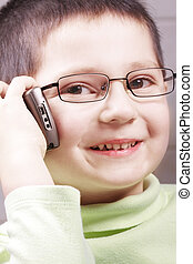 Smiling boy with cell phone