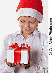 smiling boy with christmas gift box.