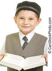 Smiling boy with open book