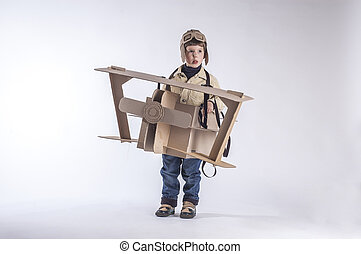 smiling boy with plane