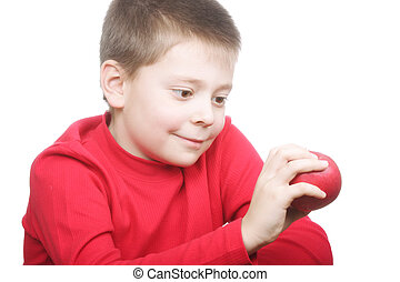 Smiling boy with red apple
