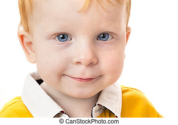 Smiling boy with red hair