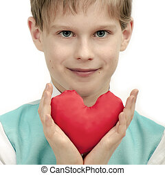 Smiling boy with red Heart in hands