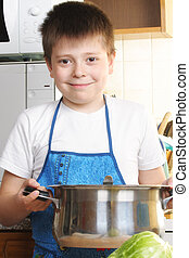 Smiling boy with saucepan