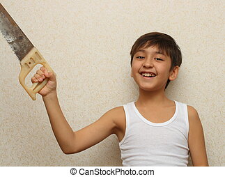 smiling boy with saw