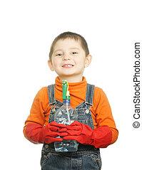 Smiling boy with spray