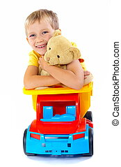 Smiling boy with toys