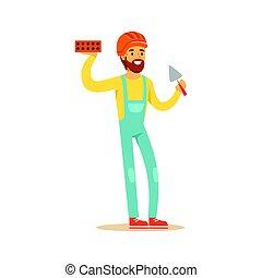 Smiling bricklayer wearing orange safety helmet and work...