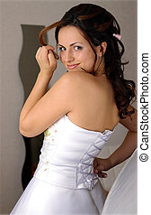Smiling bride in white dress