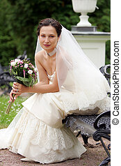Smiling bride in traditional white wedding dress