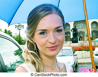 bride with blue umbrella