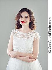 Smiling bride woman in white wedding dress fashion portrait