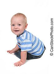 Smiling Bright Baby Boy Sitting and Looking Back on White...