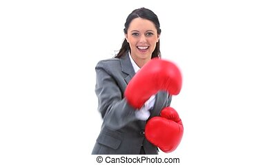 Smiling brunette boxing