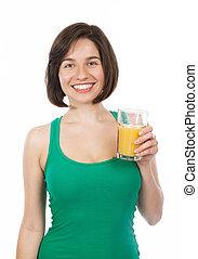 Smiling brunette drinking an orange juice
