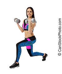 Smiling brunette exercising with dumbbells