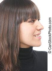 Smiling brunette in black sideview