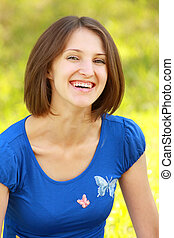 Smiling brunette in blue
