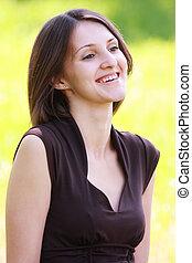 Smiling brunette in brown