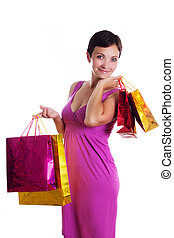 Smiling brunette in dress with shopping bags
