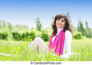 Smiling brunette in grass