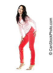 Smiling brunette in red jeans