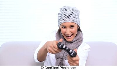 Smiling brunette playing video games