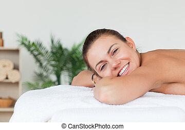 Smiling brunette waiting for a massage