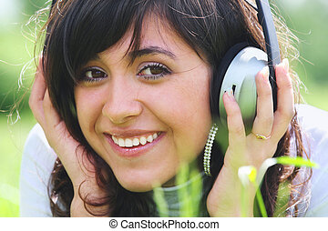 Smiling brunette with headphones