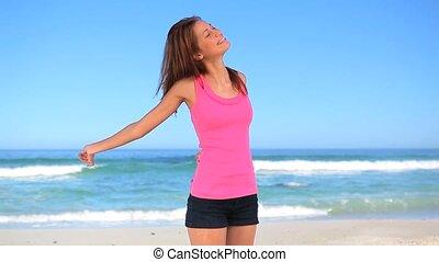 Smiling brunette woman enjoying the sun