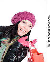 smiling brunette woman in fall clothes holding shopping bags