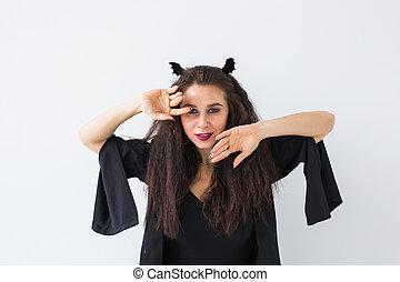 Smiling brunette woman in halloween makeup posing