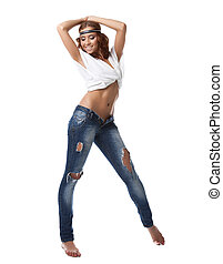 Smiling brunette woman in jeans