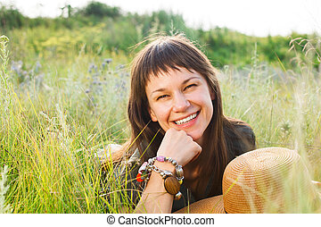 Smiling brunette woman in summer day