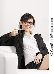 Smiling brunette woman on sofa