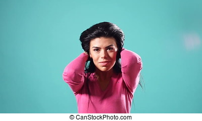 Smiling brunette woman playing with her hair and looking at...