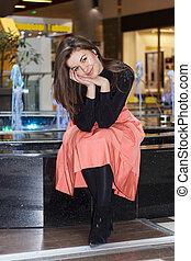 Smiling brunette woman posing